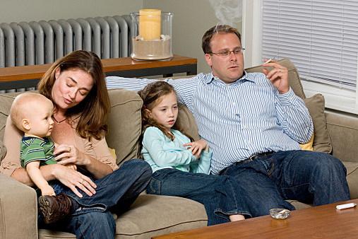 Man smoking while watching TV