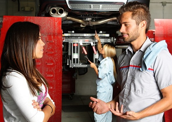 Customer talking to a mechanic