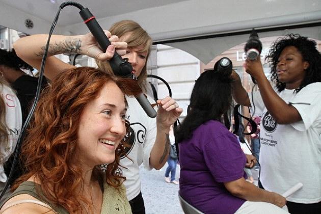 Woman having her hair styled