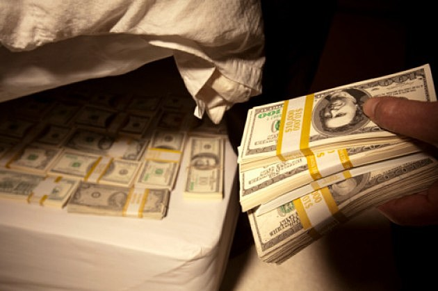 Hiding cash under a mattress