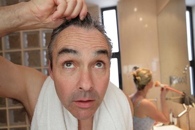 Man finding a gray hair