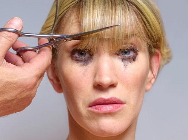 A Woman Getting Her Hair Cut