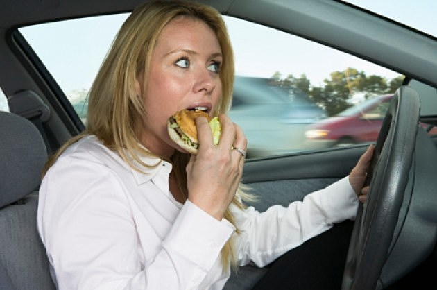 Woman Eating in Car