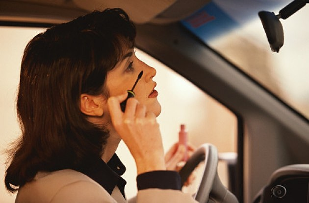 A Woman Applying Make-Up While Driving