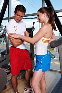 Man and Woman Flirting in the Gym
