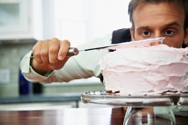 Man frosting a cake