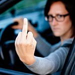 Woman Flipping the Bird to Another Driver