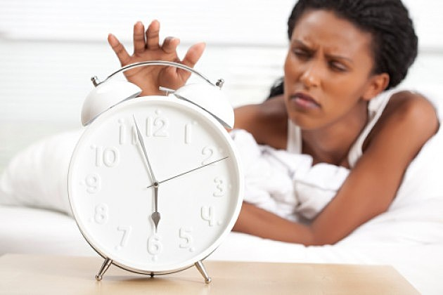Woman Hitting the Snooze Button