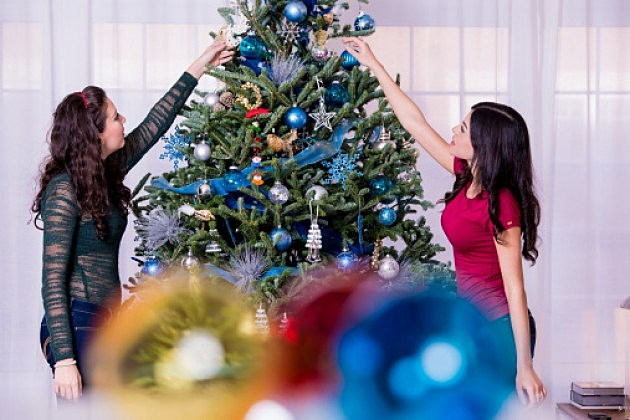 Two Women Decorating a Christmas Tree