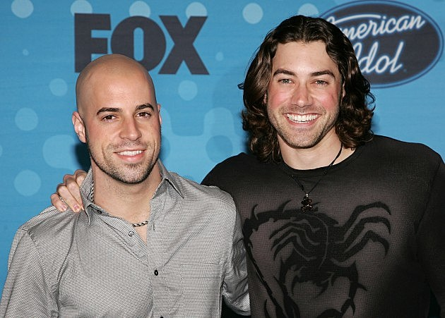 Contestants Chris Daughtry (L) and Ace Young attend a party to celebrate the American Idol top 12 finalists