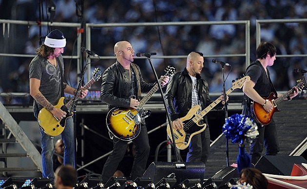 Josh Steely, Chris Daughtry, Josh Paul, and Brian Craddock of Daughtry performs at halftime during a game between the Oakland Raiders and the Dallas Cowboys at Cowboys Stadium