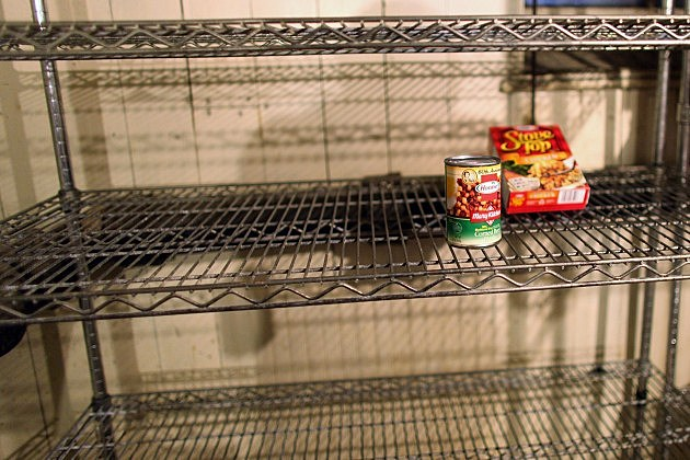 Food pantry shelf almost empty