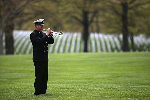 Navy bugler plays Taps at funeral