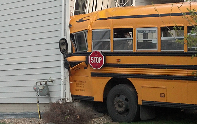 School Bus Hits House