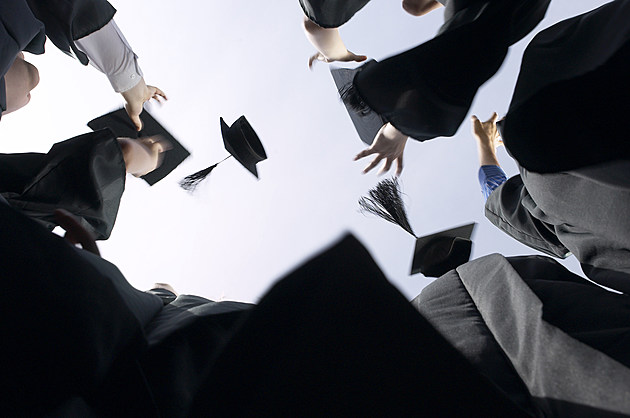 College grads throwing mortarboards