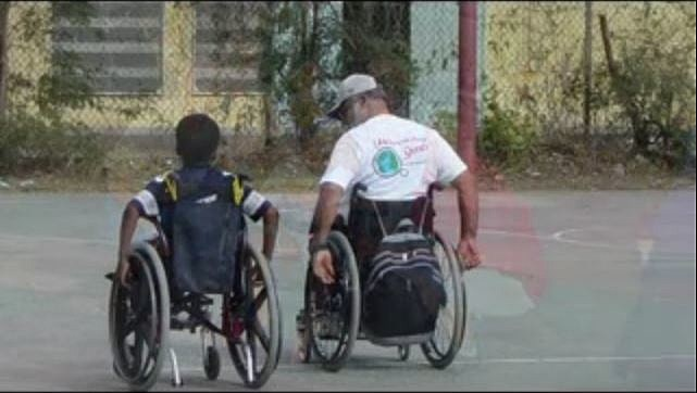 Hope Haven man and child in wheelchair