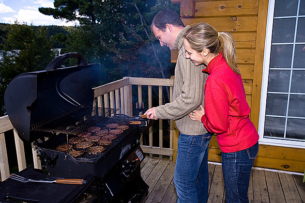 Couple grilling together