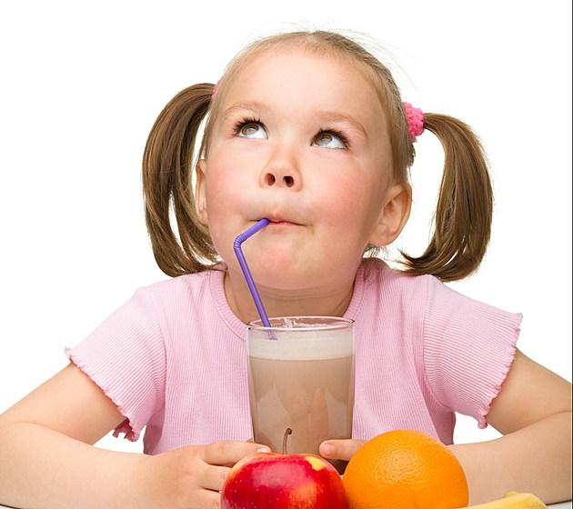 Little girl drinks chocolate milk
